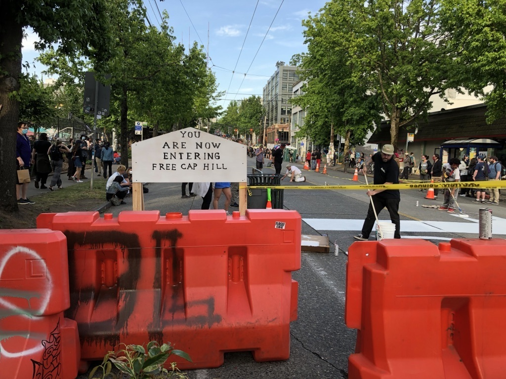 photo of barricades and sign at Seattle CHOP