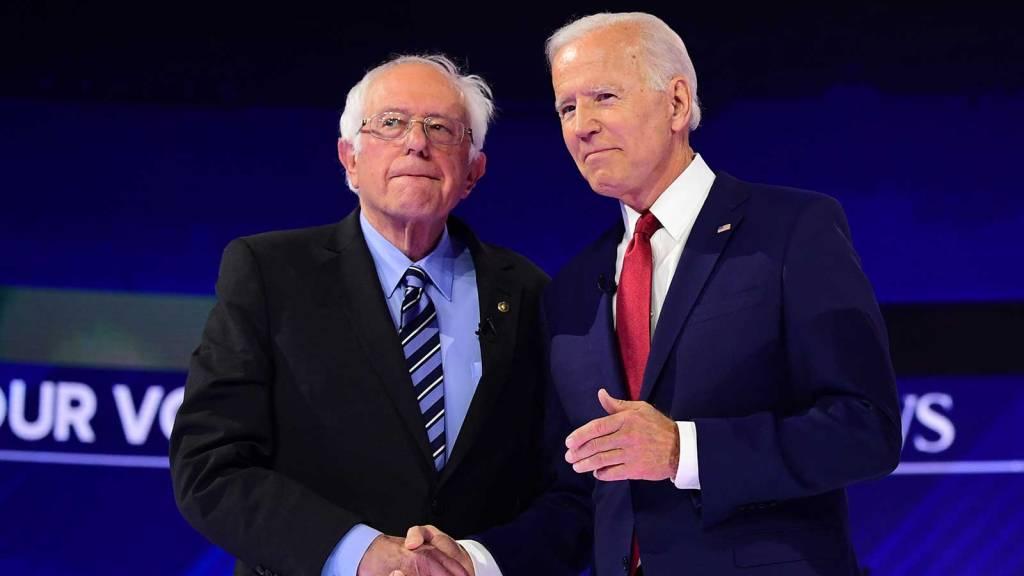 Bernie Sanders and Joe Biden shaking hands