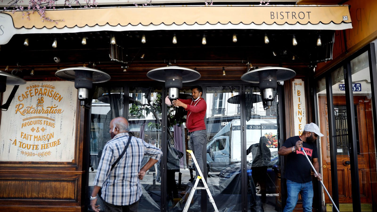 Turning off outdoor heaters at the French bistrot.