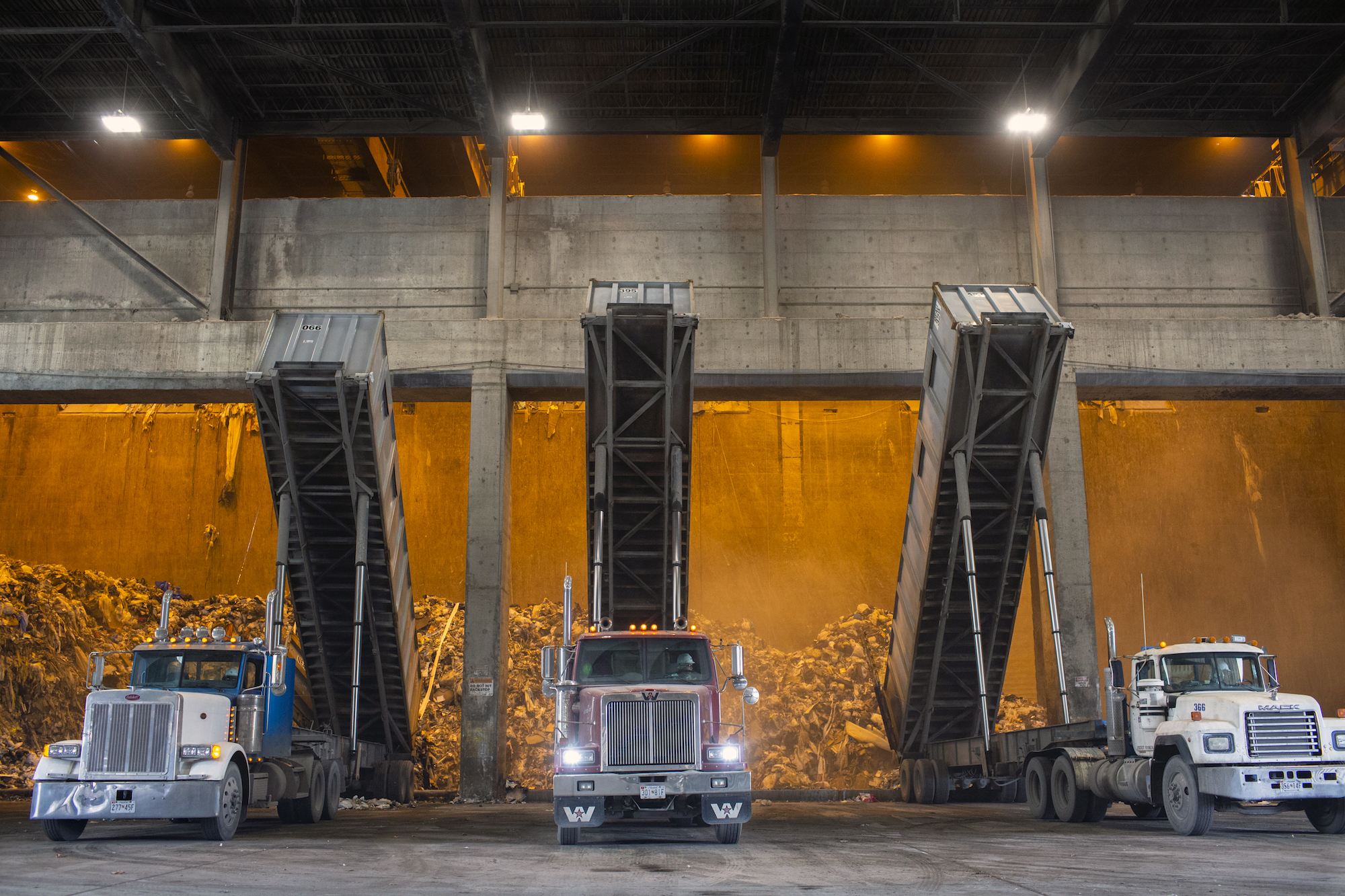 A photo of trucks dumping garbage at the Covanta incinerator in Montgomery County, Maryland