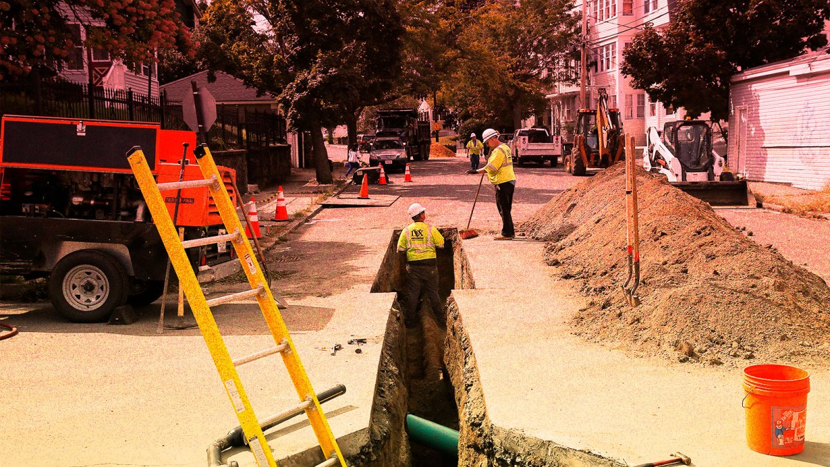 A photo of gas workers digging a trench for pipes in Massachusetts