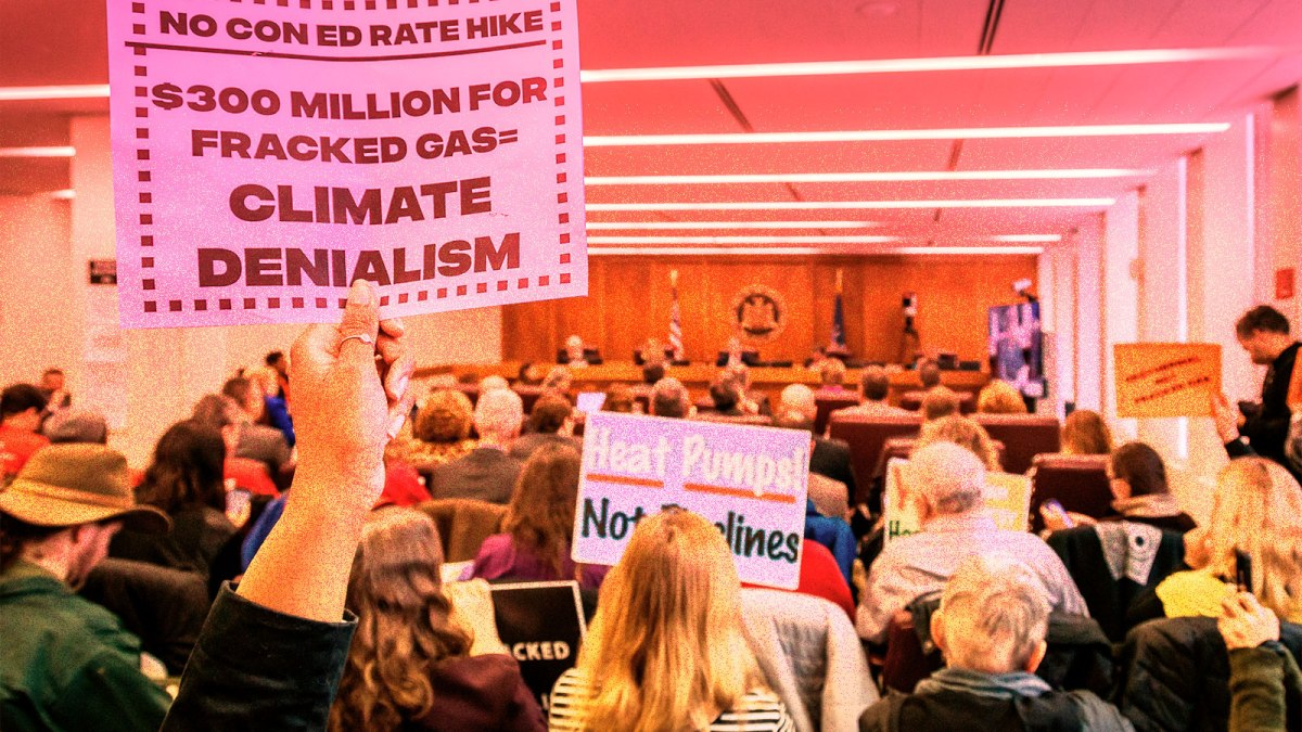 photo of protesters holding anti-fracking signs at Con Edison PSC meeting