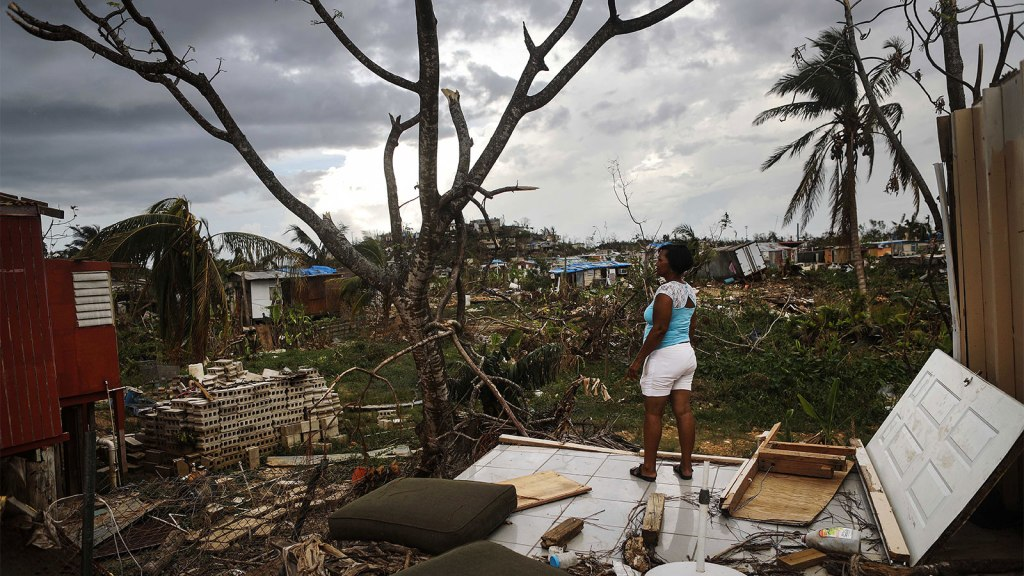 Resident Mirian Medina stands on her property about two weeks after Hurricane Maria swept through the island on October 5, 2017 in San Isidro, Puerto Rico