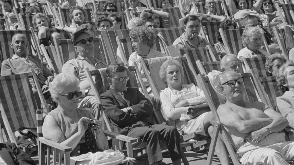 Black and white photo of rows of seniors in deckchairs in Margate, UK.