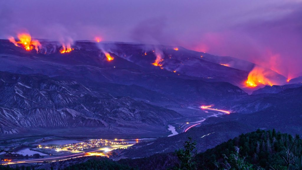 Glowing fire from Grizzly Creek Glenwood Canyon fire, Summer 2020. Dotsero, Colorado USA.