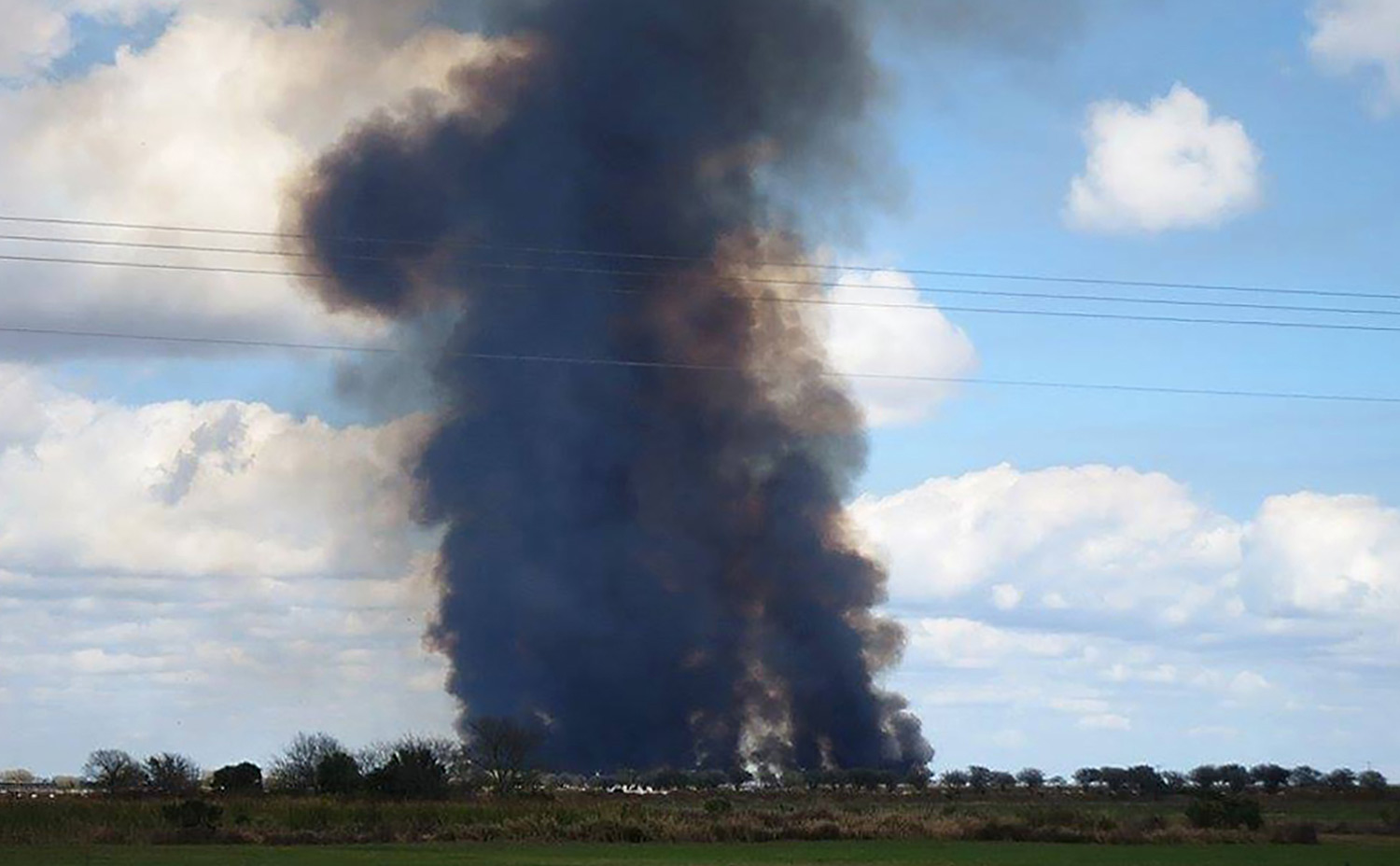 A plume of black smoke rises from a sugarcane burn outside of Clewiston, Florida.