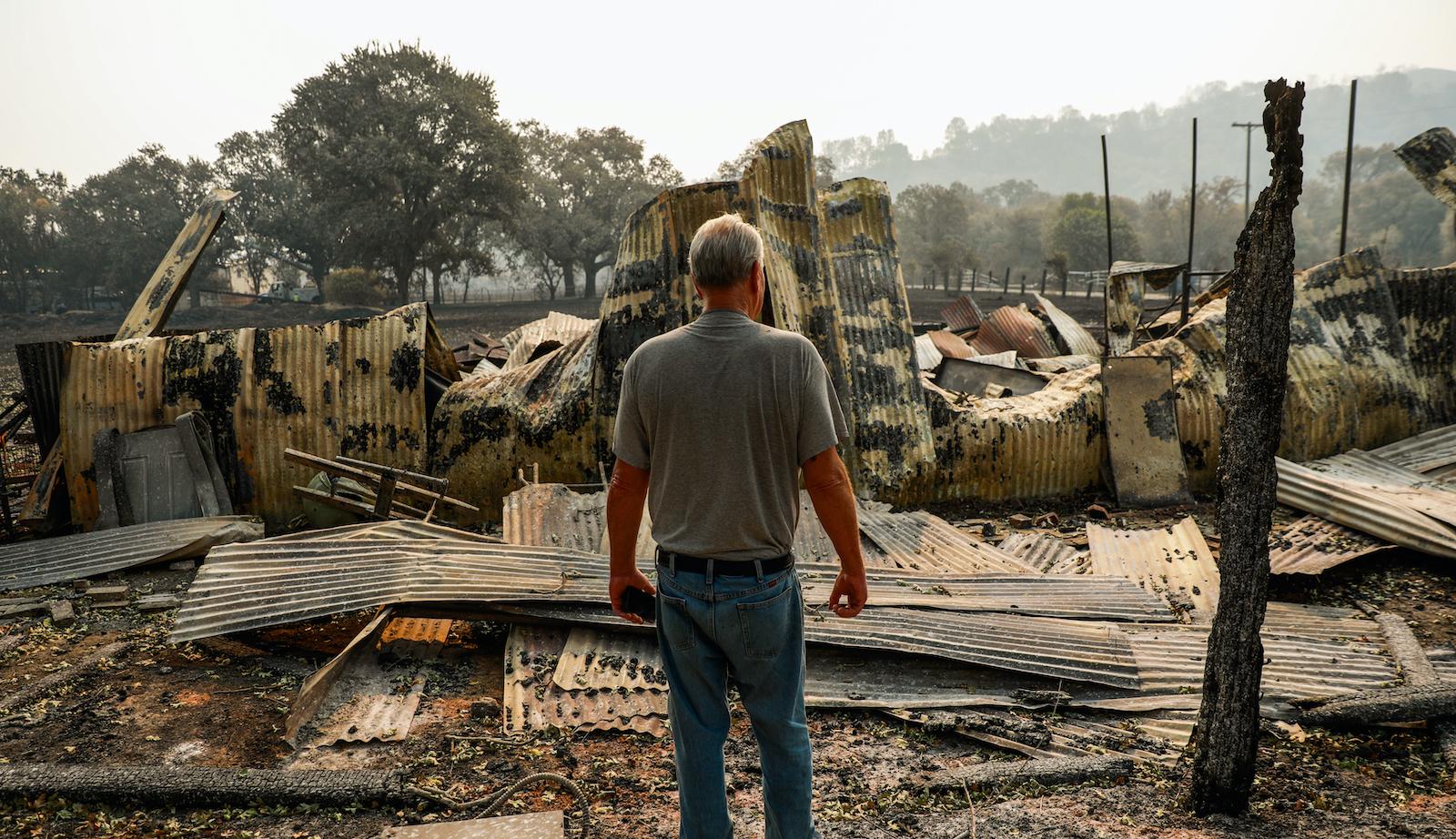 A man surveys the damage done