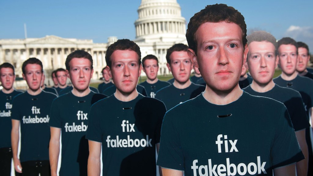 One hundred cardboard cutouts of Facebook founder and CEO Mark Zuckerberg stand outside the US Capitol