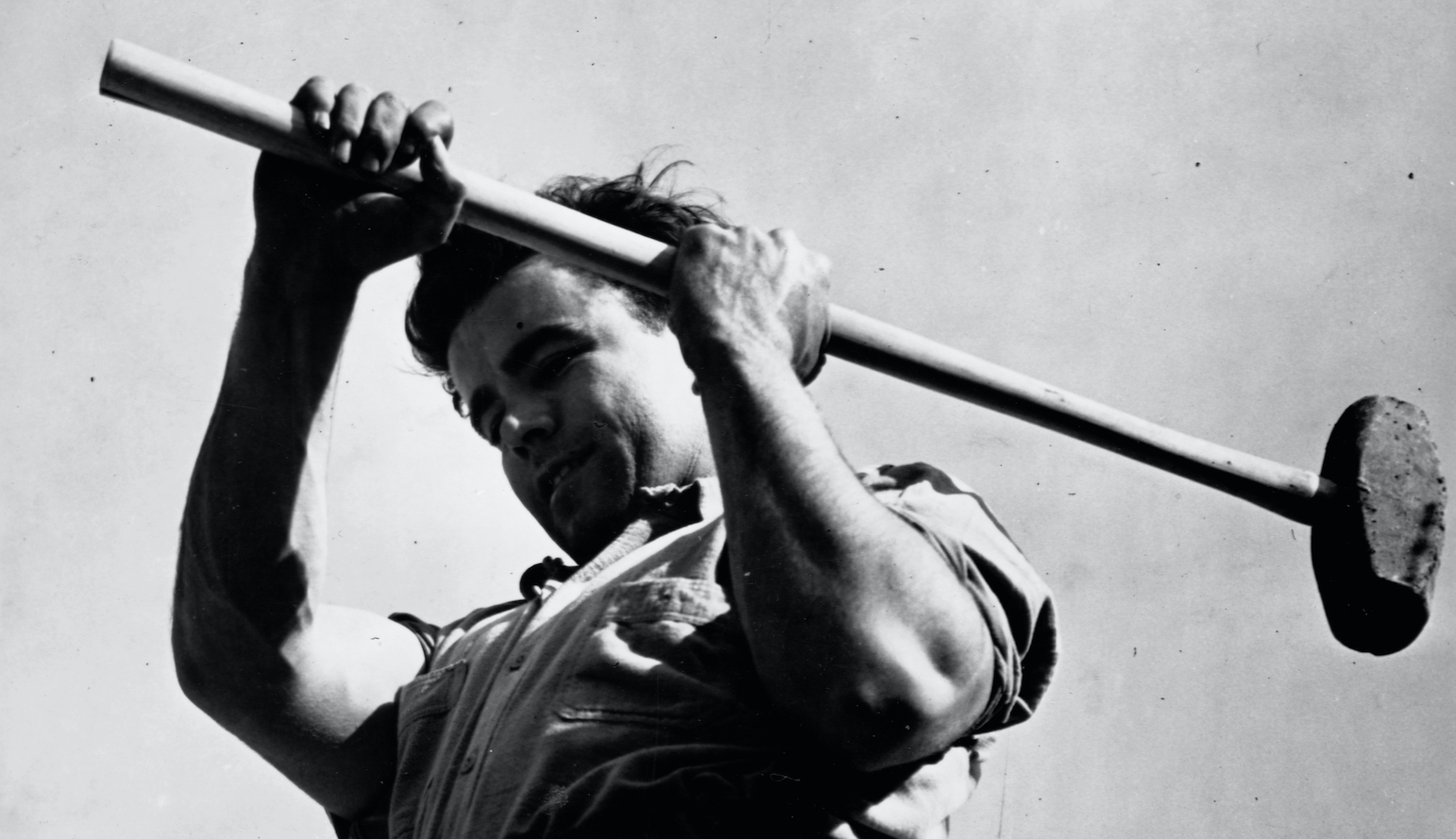 Man Swinging Sledge Hammer