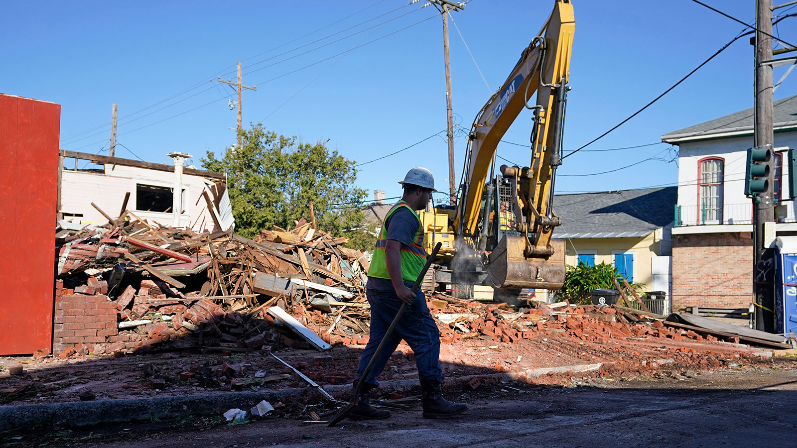 Workers remove debris from an unoccupied structure that collapsed yesterday as Hurricane Zeta passed through in New Orleans, Thursday, Oct. 29, 2020.