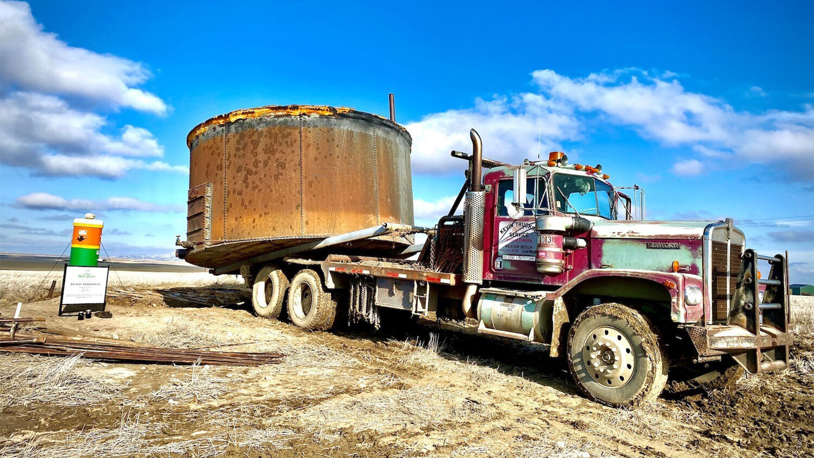 photo of truck pulling large oil tank