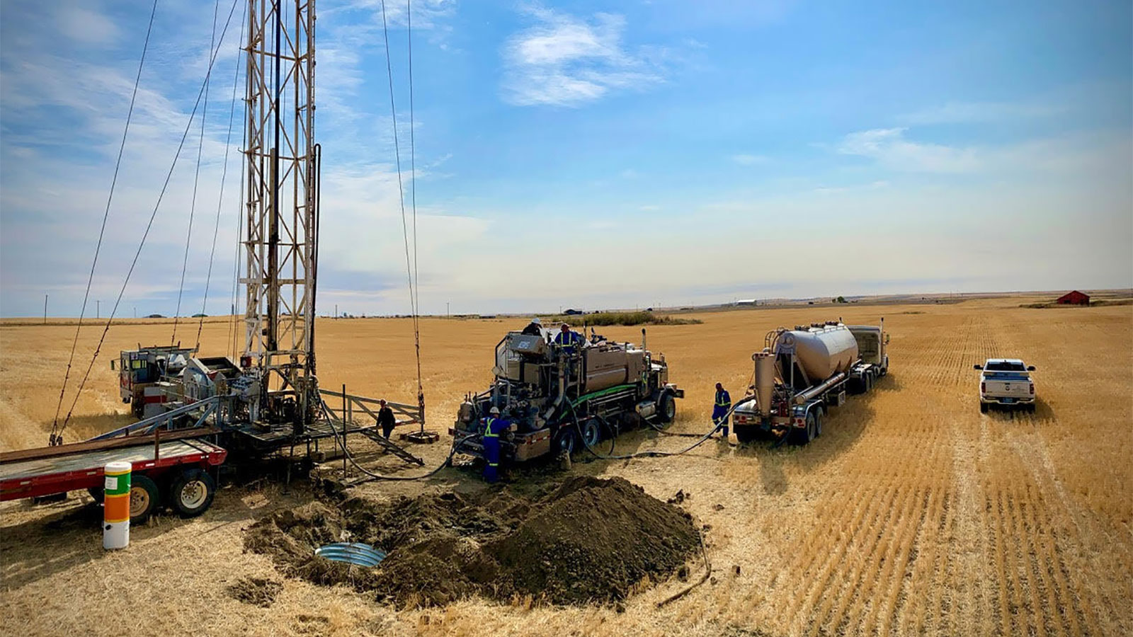 photo of volunteers with trucks plugging abandoned oil well