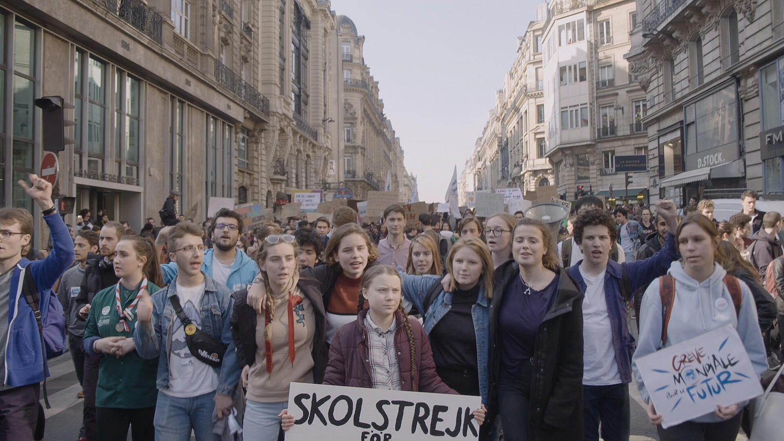 Greta Thunberg marches with fellow youth activists.