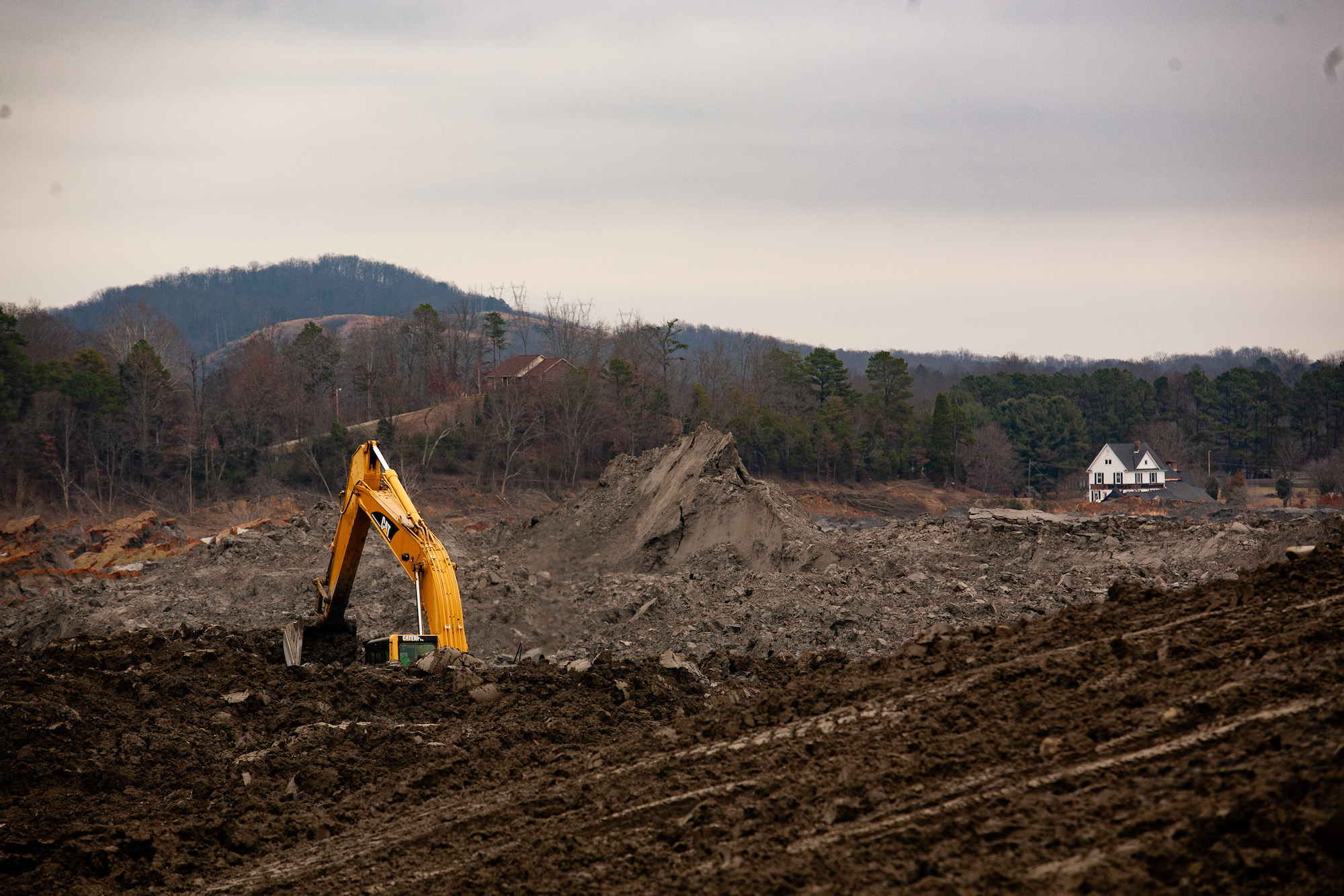 A house overlooks coal fly ash slurry released from the TVA's Kingston Fossil Plant.