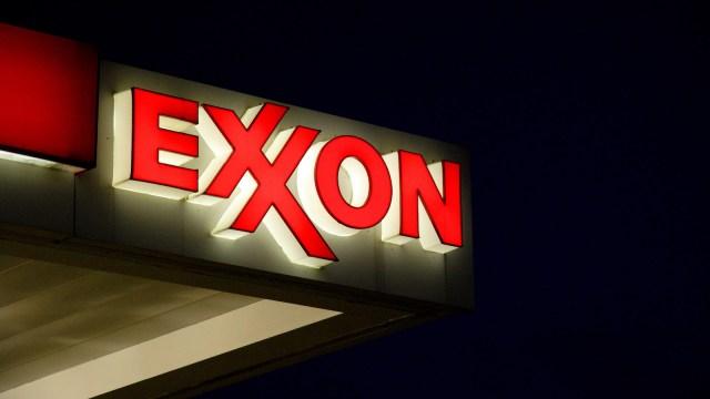 An Exxon gas station sign against a dark night sky