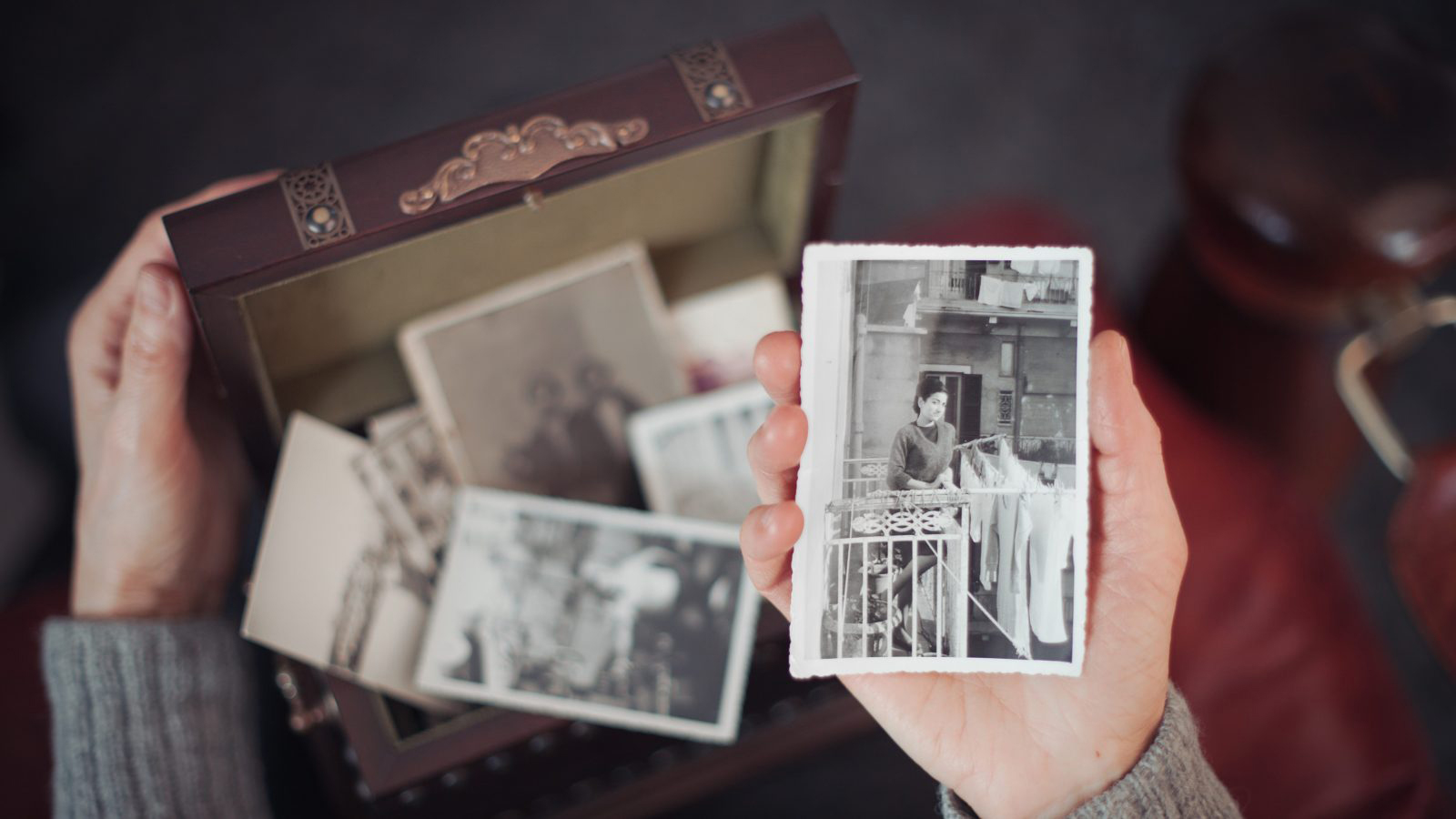 Woman discovering old photographs