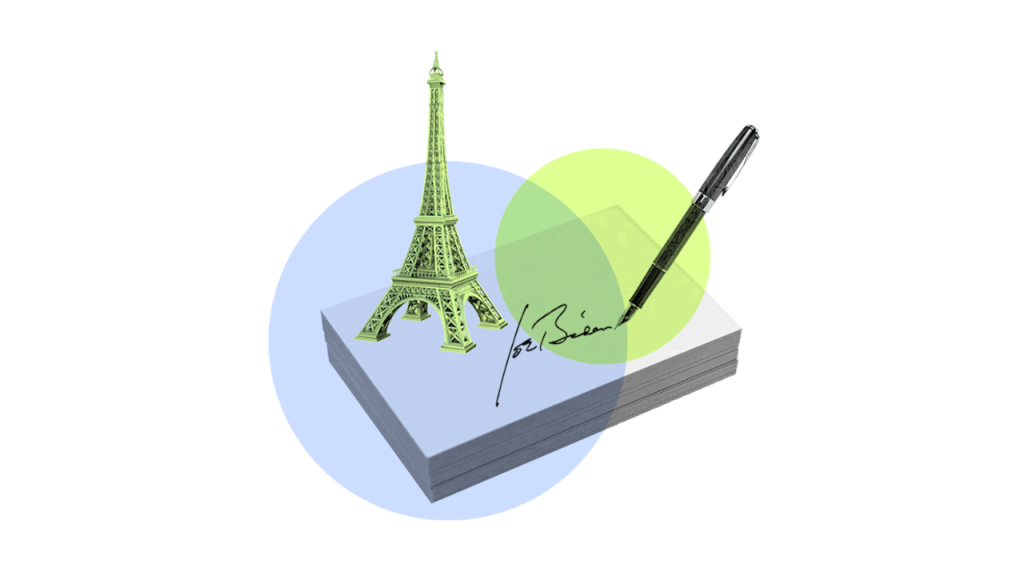 President Biden's signature and a tiny Eiffel tower, representing his executive order for the US to rejoin the Paris Climate Agreement