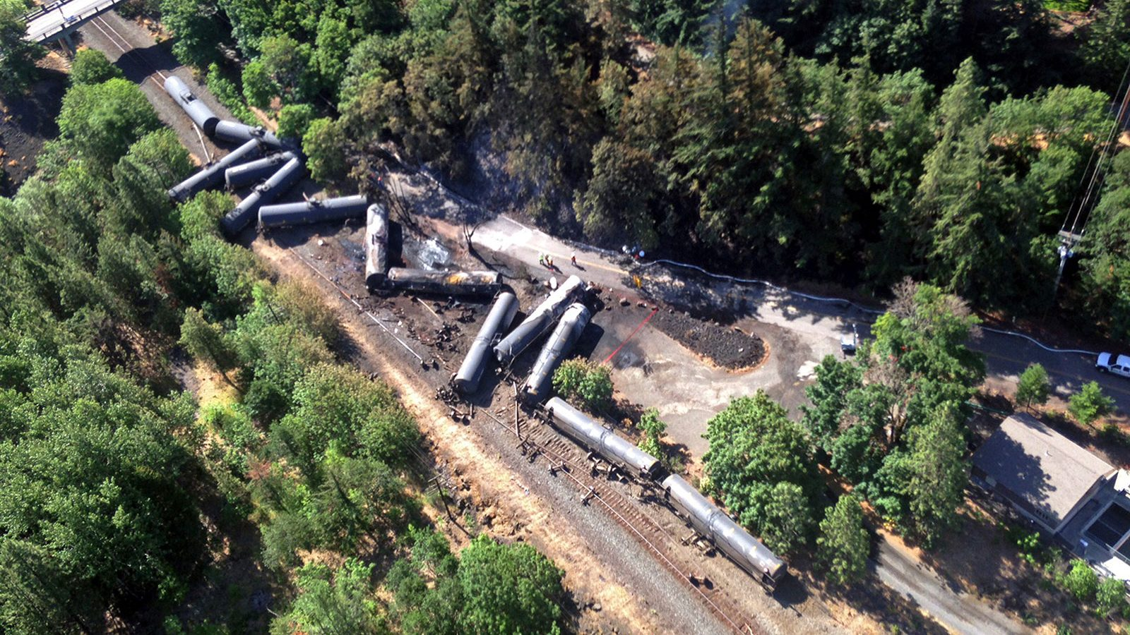 Scattered and burned oil tank cars after a train derailed and burned near Mosier, Oregon.