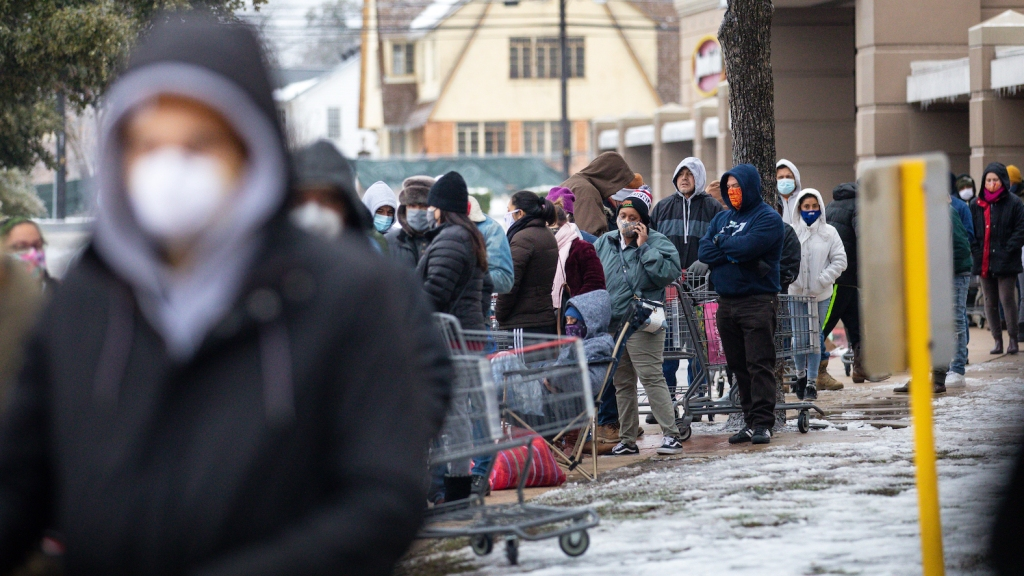 AUSTIN, TX - FEBRUARY 17, 2021: People wait in long lines at an H-E-B grocery store in Austin, Texas on February 17, 2021. Millions of Texans are still without water and electric as winter storms continue.