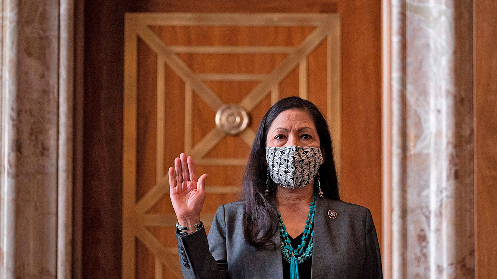 A photograph of Congresswoman Deb Haaland, D-N.M., is sworn in during the Senate Committee on Energy and Natural Resources hearing on her nomination to be Interior Secretary on Capitol Hill in Washington, DC, on February 23, 2021.