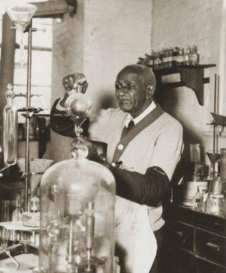 George Washington Carver in his lab