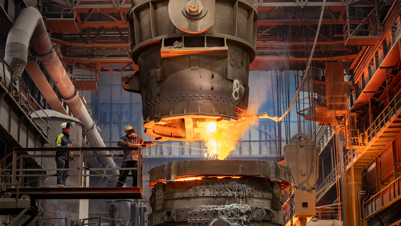 pouring molten steel in a steelworks
