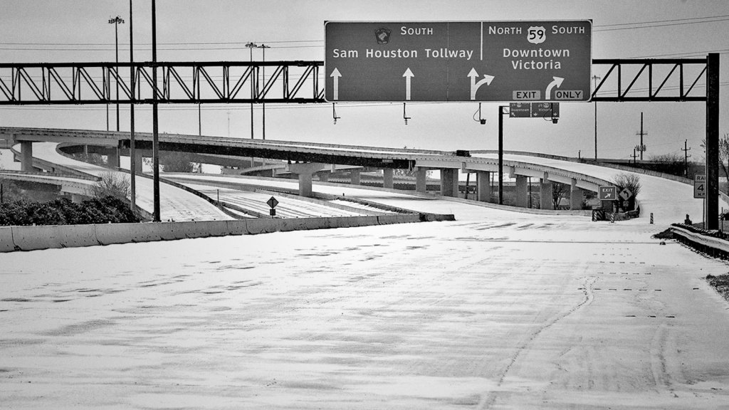 Black and white photograph of an ice covered, closed highway in Houston, Texas.