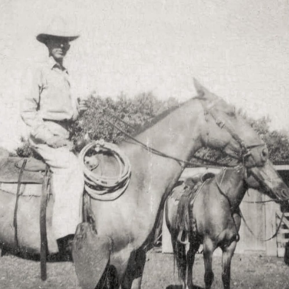 Black and white photo of Brack Goolsby on a horse