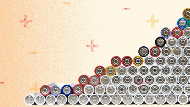 A stack of batteries with plus and minus signs