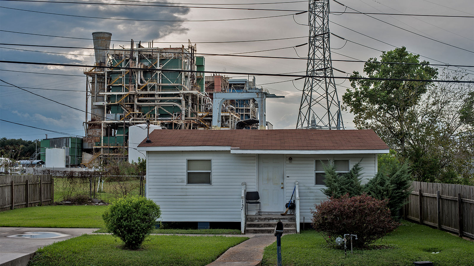 A house in front of a refinery in what is known as