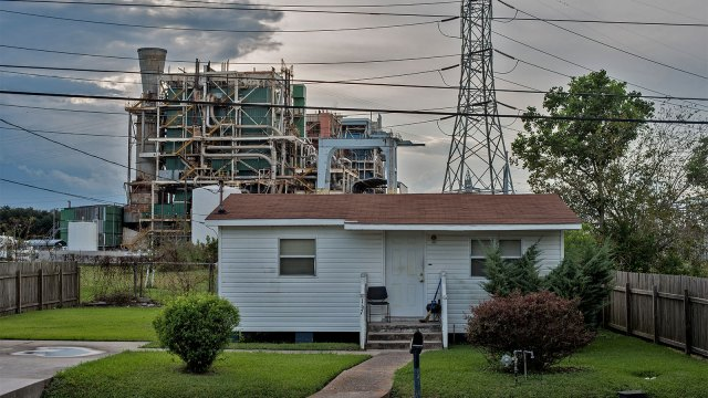"A house in front of a refinery in what is known as ""cancer alley"" in Louisiana"