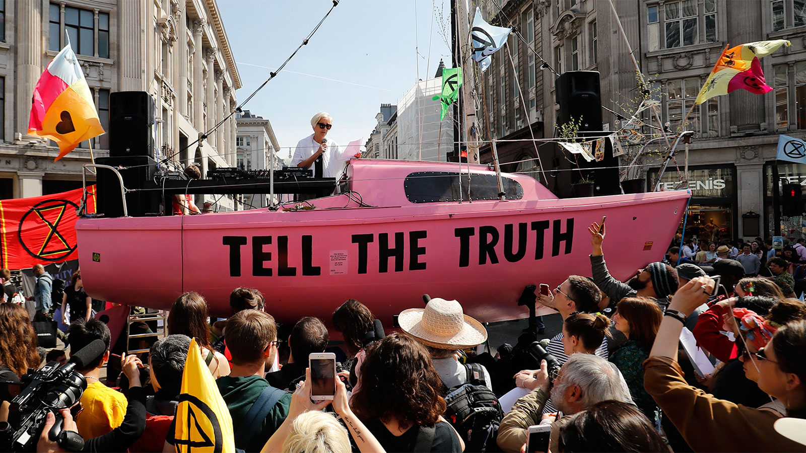 British actress Emma Thompson gives an address from the stage atop a pink boat during an Extinction Rebellion protest