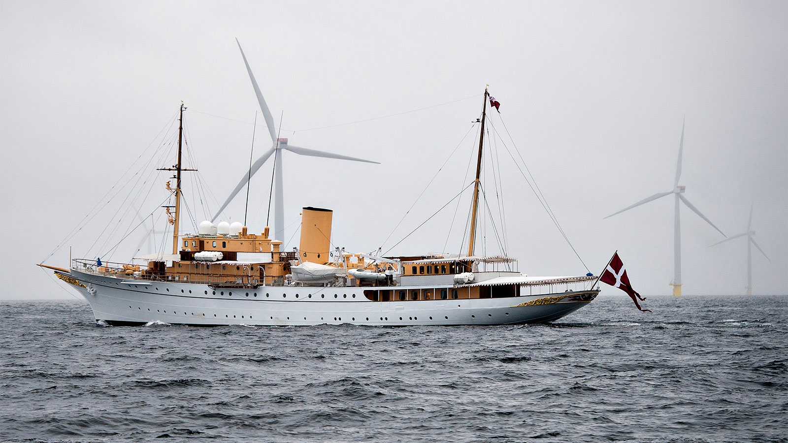The Royal Danish Yacht passes by Denmark's largest offshore wind farm off of Anholt Island