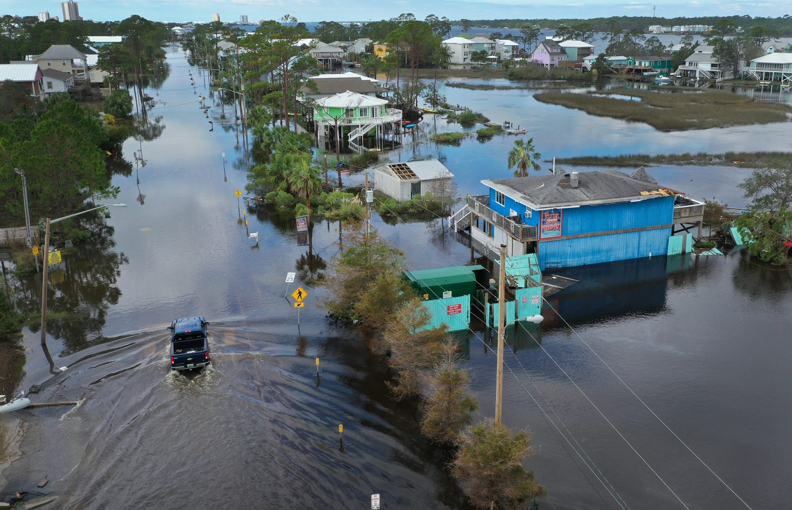 An aerial view from a drone shows a vehicle driving through a flooded street after Hurricane Sally passed through the area on September 17, 2020 in Gulf Shores, Alabama. The storm came ashore with heavy rain and high winds.