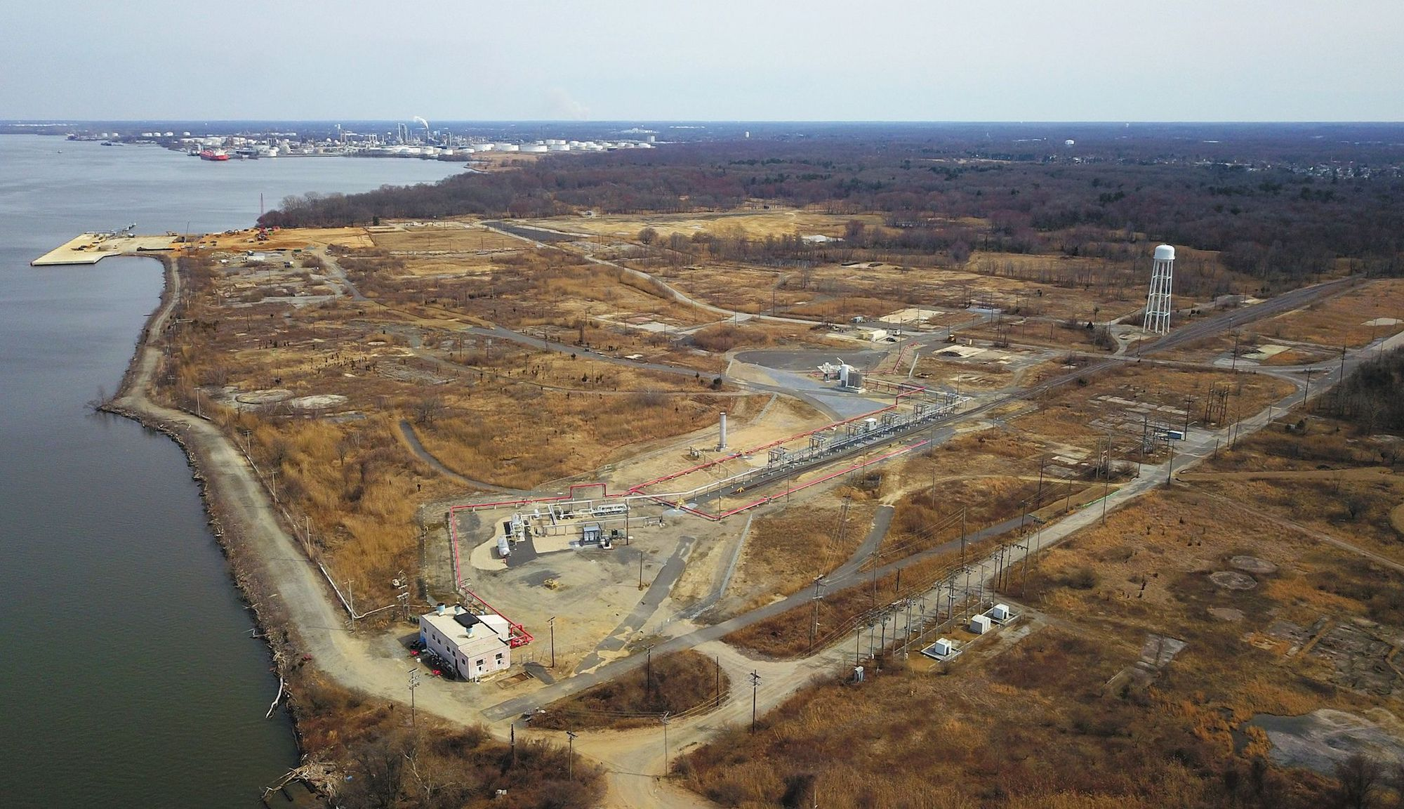 an aerial view of a mostly empty lot surrounded by brown landscape