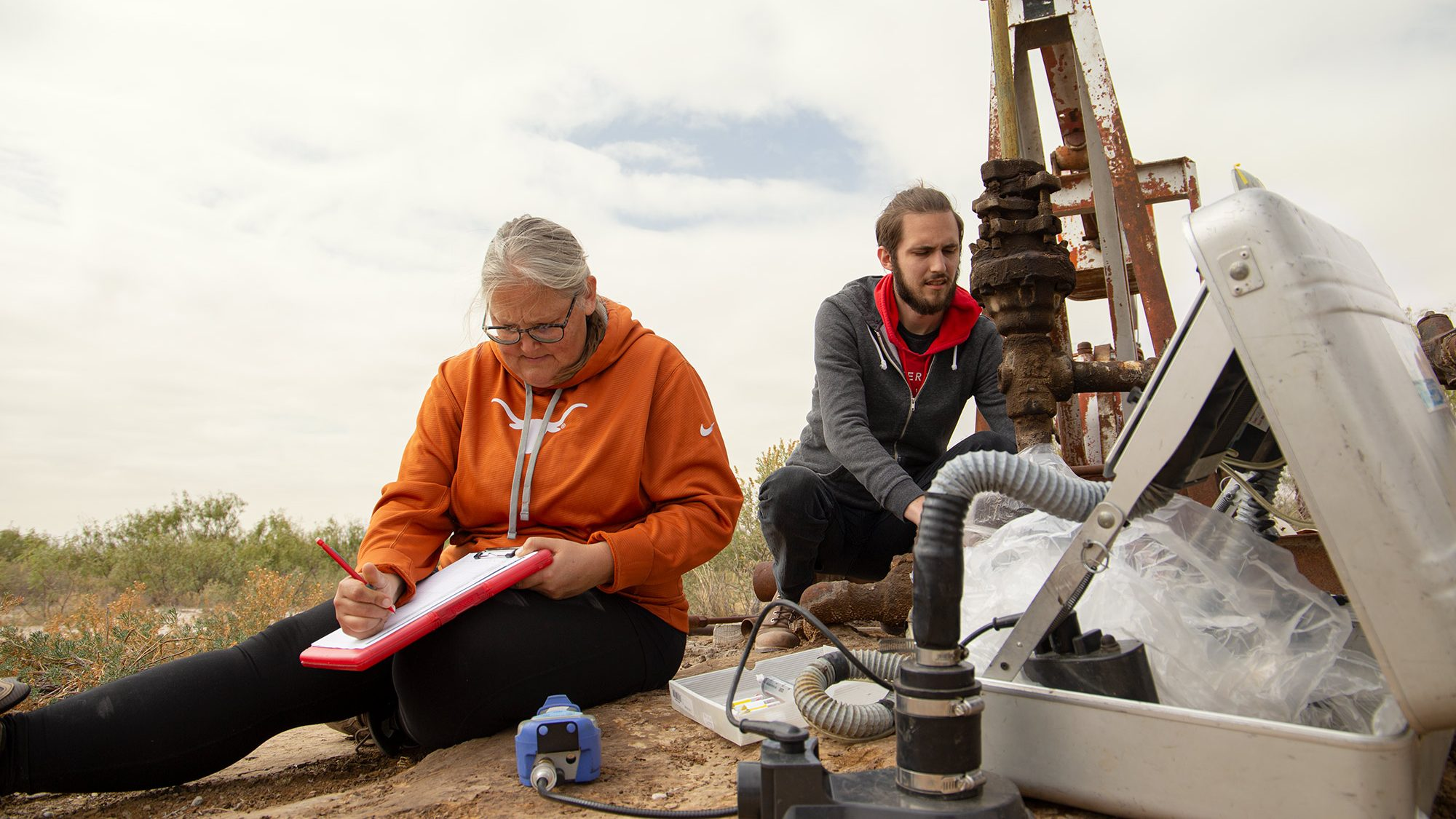 Amy Townsend-Small and assistant measuring methane from well