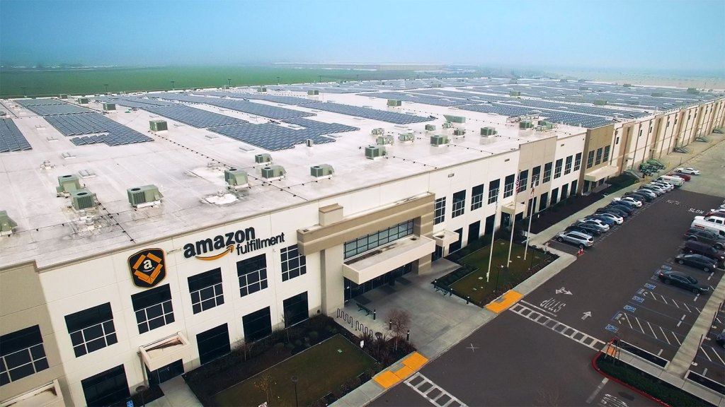 Amazon fulfillment center with solar panels on the roof