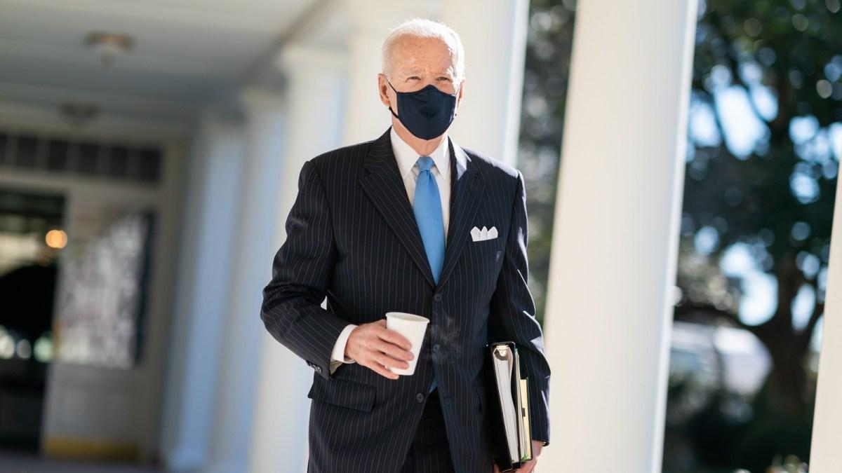 Biden walking outside with mask on