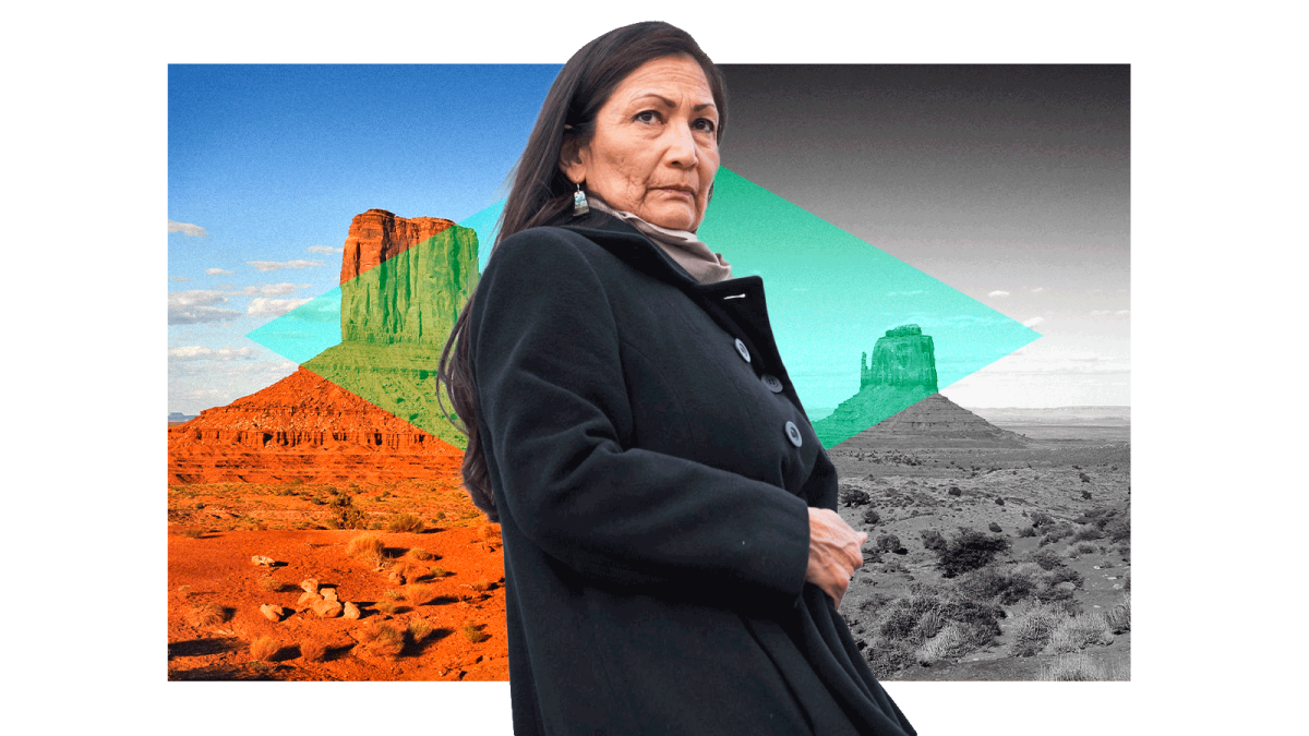 Deb Haaland against a background of the Navajo Nation