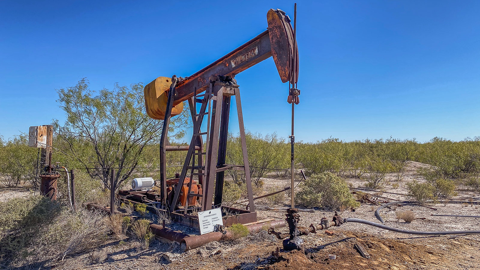 rusted pumpjack abandoned oil well