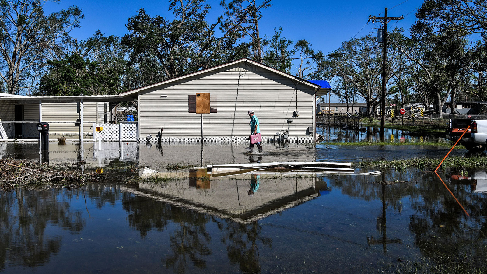 A man in front of his house in flooded Lake Charles, Louisiana