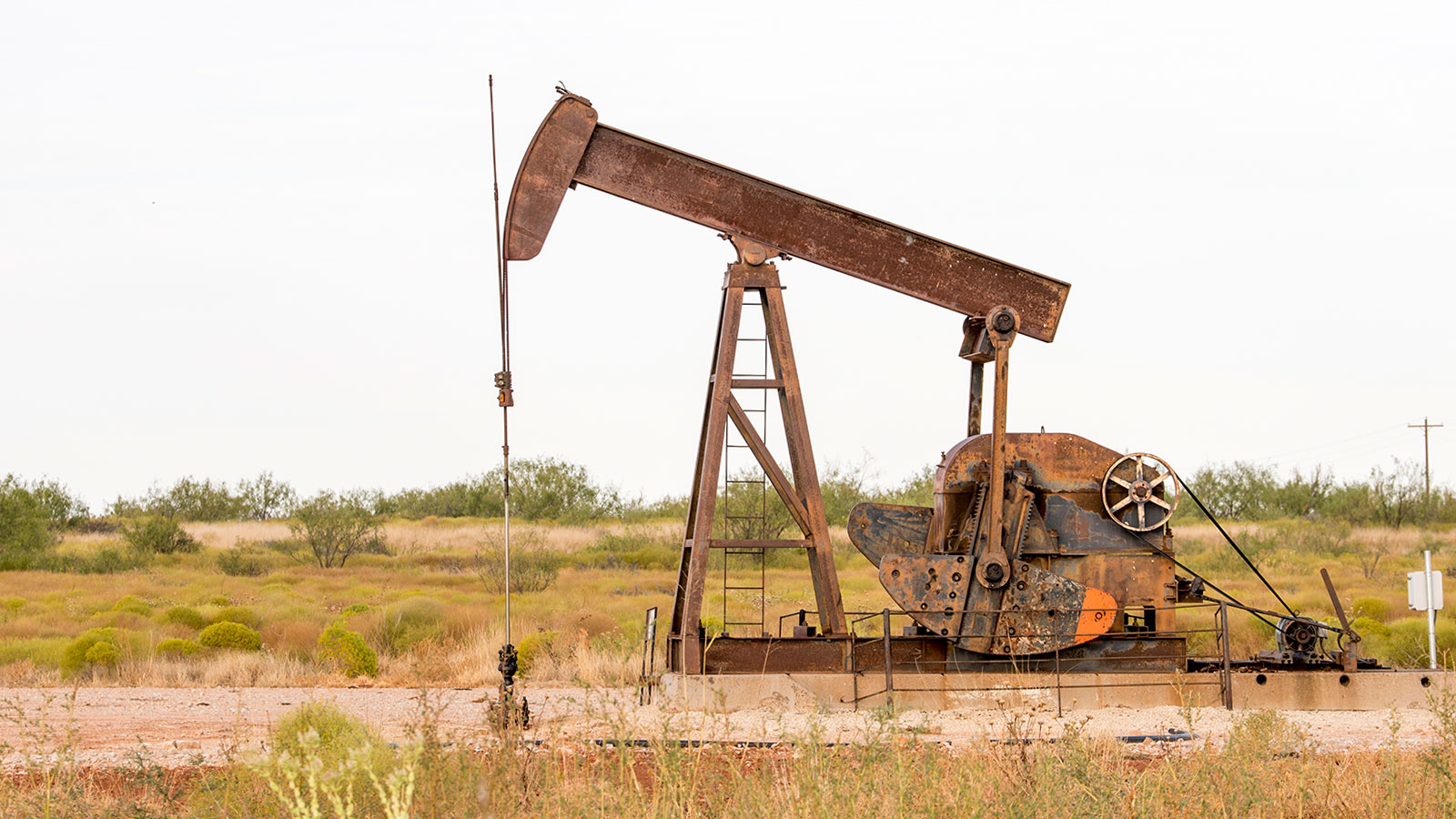 Photograph of a rusty oil pumpjack