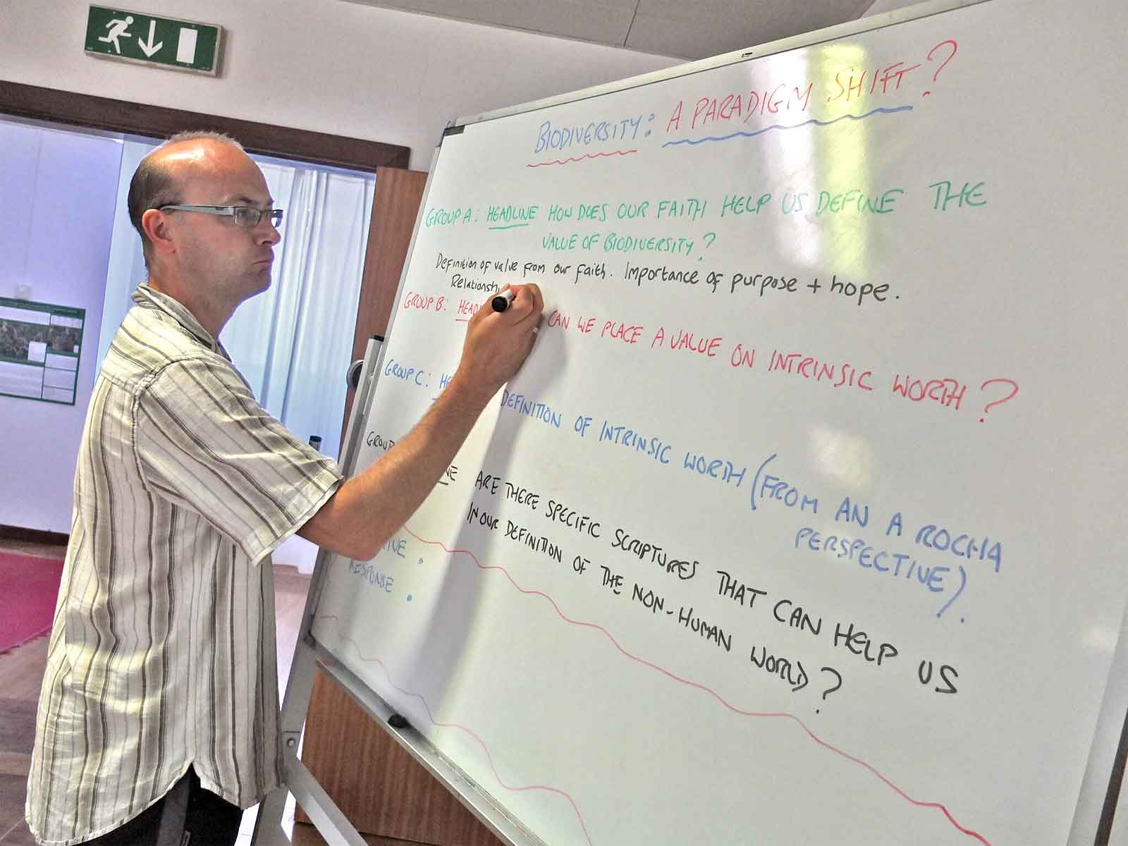An A Rocha volunteer takes notes during a brainstorm on religion and biodiversity at a leader's forum in Portugal.