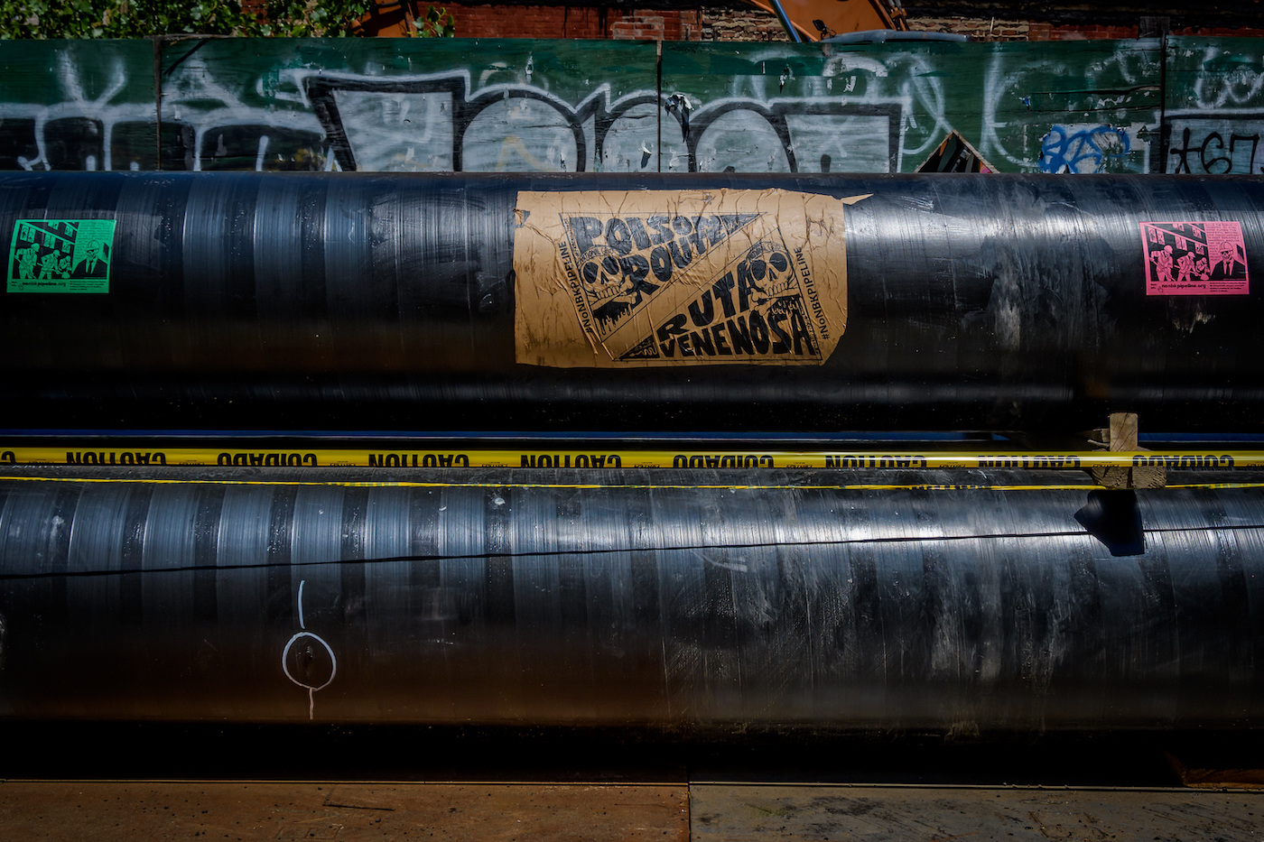 a pipeline with a protest sign glued to it