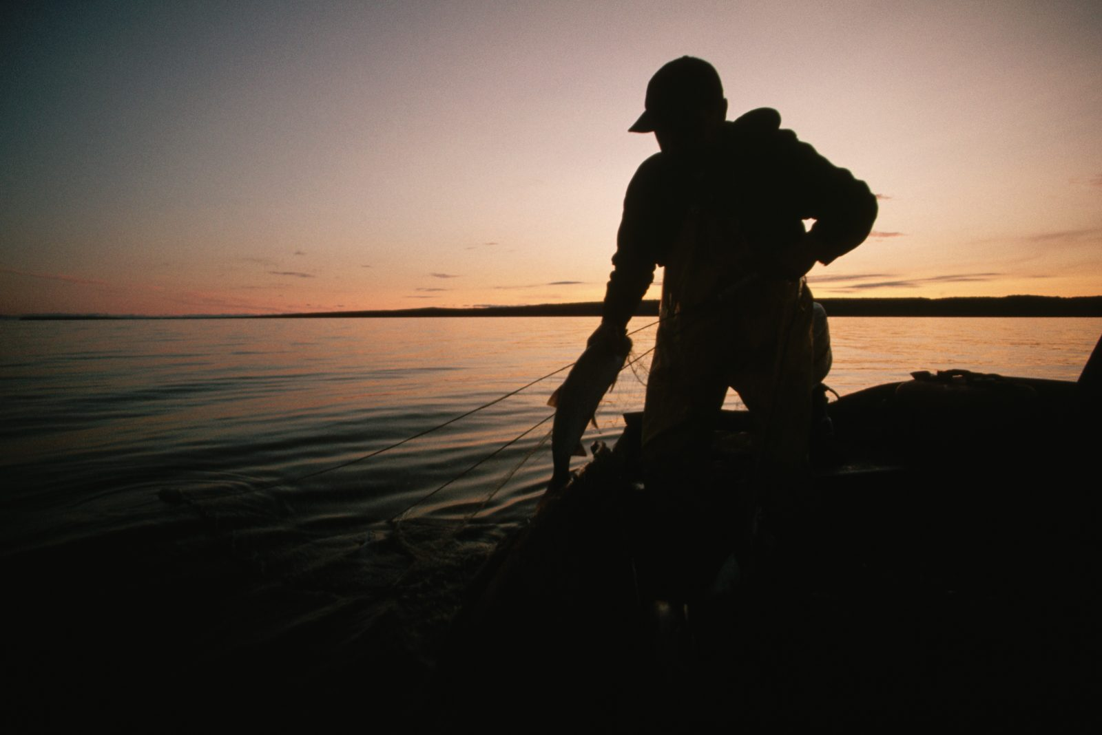A silhouette of a Great Lake fisherman.