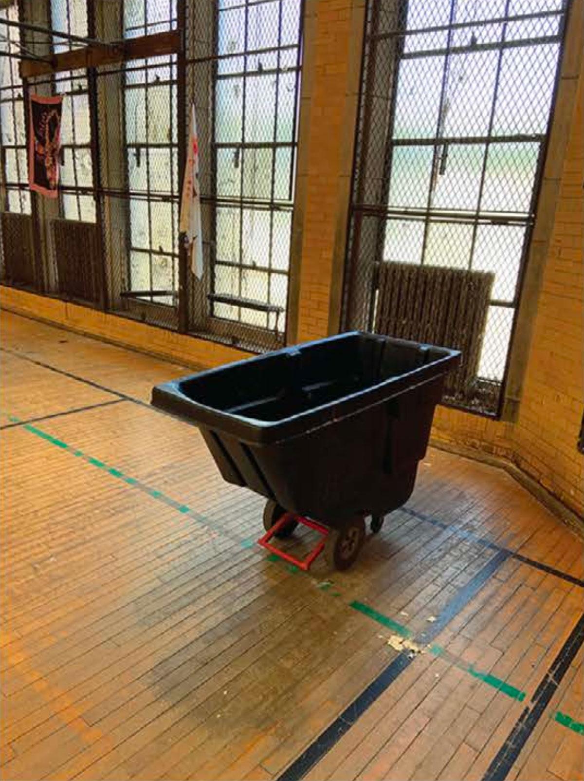 A rolling bin used to catch leaking water