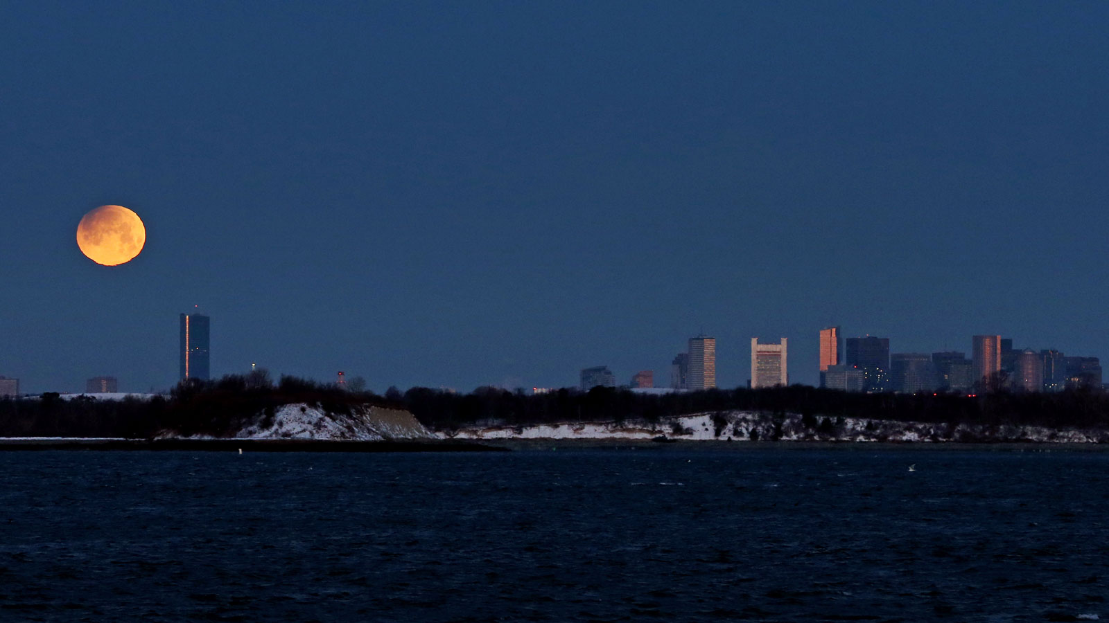 A super blue blood moon setting over Boston