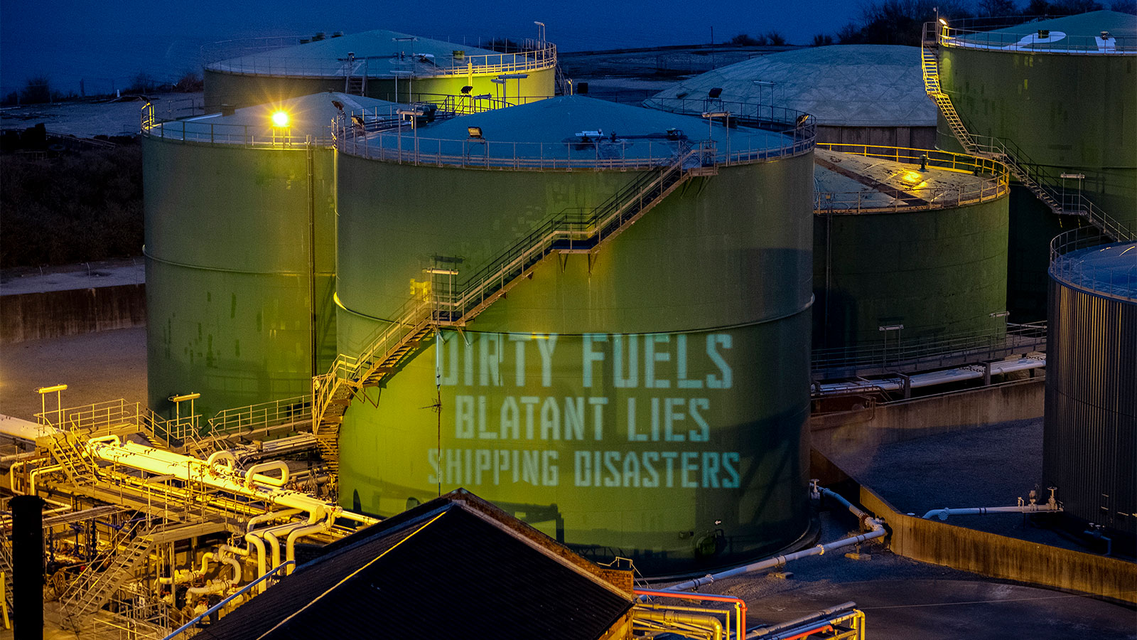 A projected slogan protesting the fuel shipping industry
