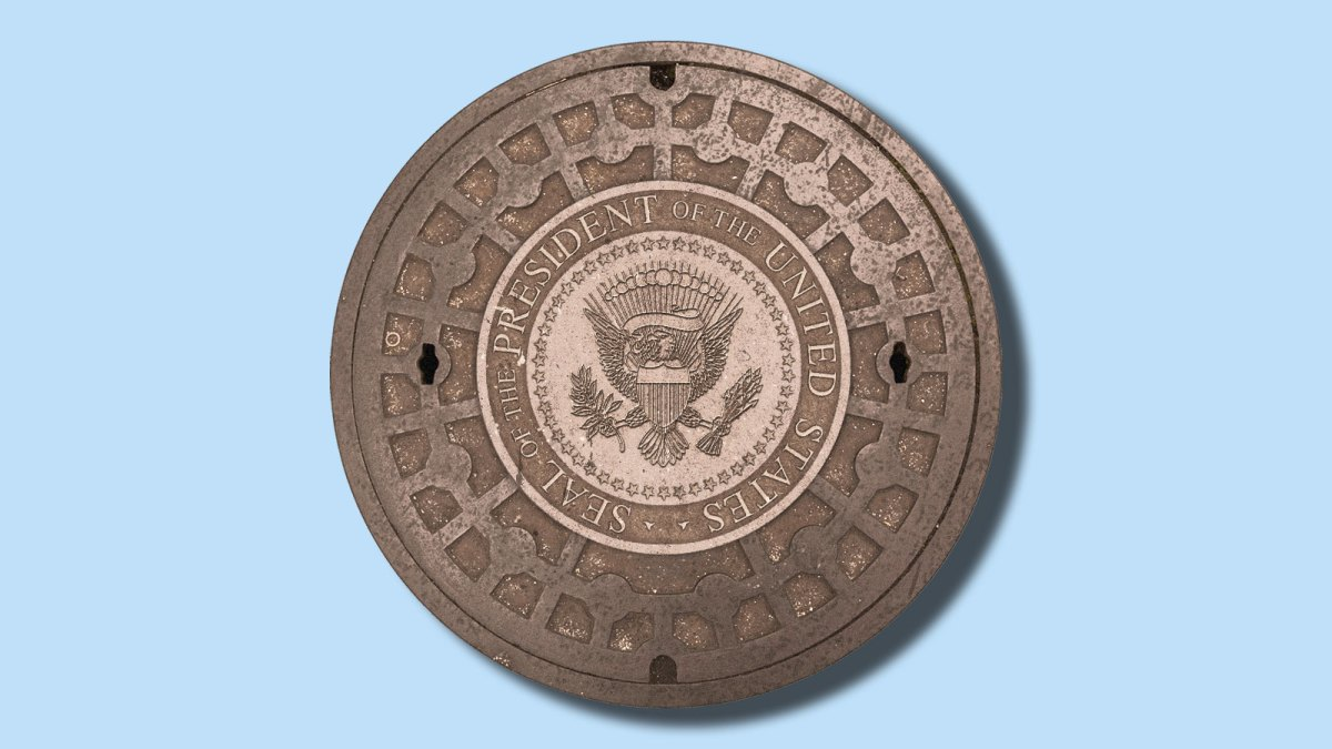 A manhole cover with the seal of the President of the United States embossed on it