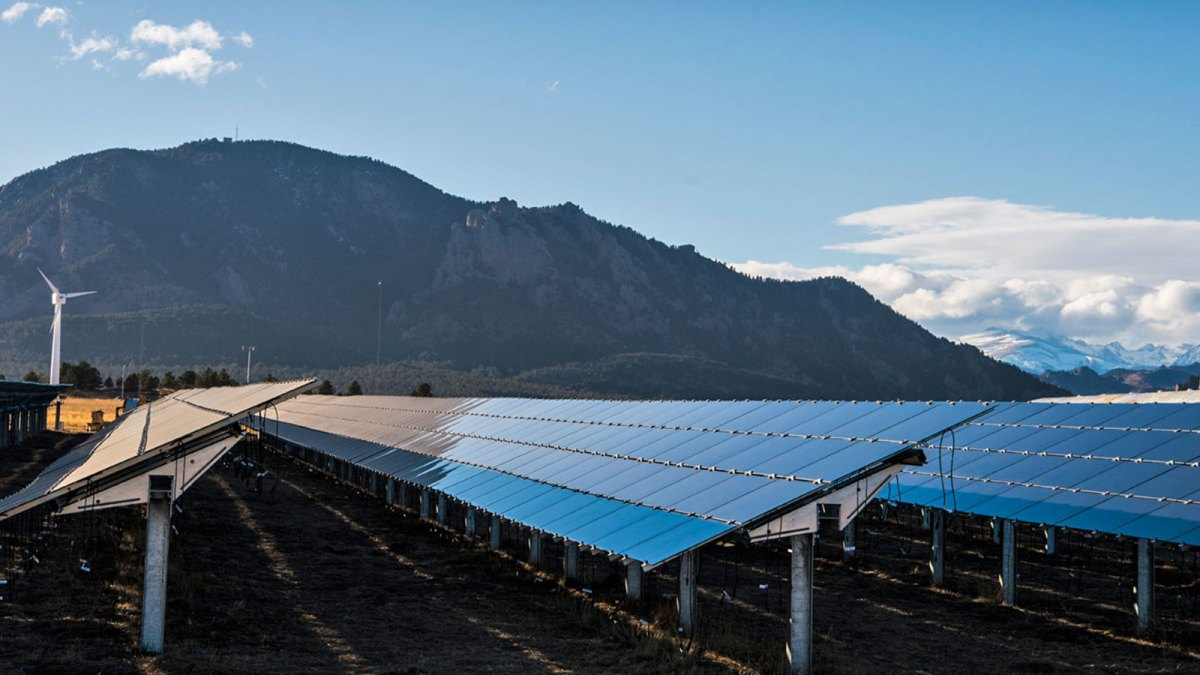 Solar panels with mountains in the background